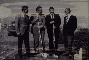 People posing with shovels